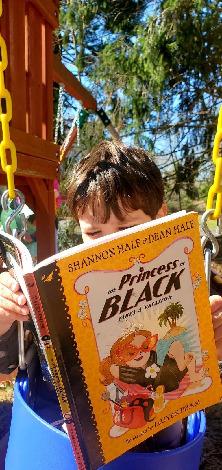 Boy reading princess in black series